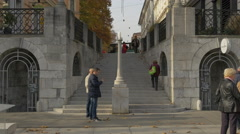 People walking, taking the stairs and a kid playing in Ljubljana Stock Footage