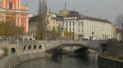Many people crossing the Triple Bridge (Tromostovje) in Ljubljana Stock Footage