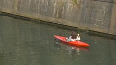 Woman canoeing on Ljubljanica River in Ljubljana Stock Footage