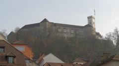 Fortress of Ljubljana and house rooftops in Ljubljana Stock Footage
