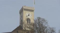 Flag waving on top of Ljubljana Castle's tower in Ljubljana Stock Footage