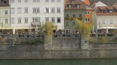 Relaxing by Ljubljanica River in Ljubljana Stock Footage