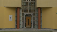 Facade of a modern yellow building in Ljubljana Stock Footage
