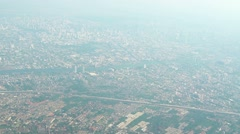 Airborne View of a Sprawling, Asian Cityscape on a Foggy Day. Video 1080p - stock footage