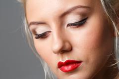Beautiful woman face with makeup. Beauty fashion concept - stock photo
