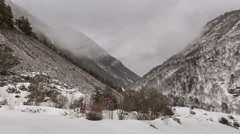North Ossetia. The movement of clouds in the snowy Caucasus mountains in winter Stock Footage