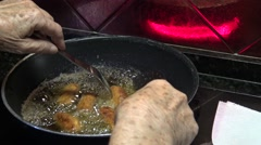 4k Spanish grandma is cooking a croquettes in pan with olive oil of a kichen-Dan Stock Footage