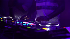 DJ performing at a night party. - stock footage