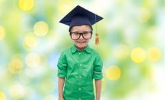 happy boy in bachelor hat or mortarboard - stock photo