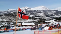Norwegian National flag waves at the ski resort in Hemsedal, Norway. Stock Footage