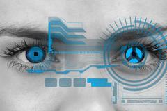 Eyes scanning a futuristic interface Stock Photos