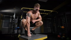 portrait of handsome sportive man in gym - stock footage