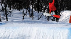 People jump at the snowpark at the ski resort in Hemsedal, Norway. Stock Footage