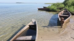 Wooden Boats on Sand near Shore. - stock footage