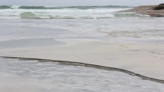 Small Clear Stream flowing into Sea. - stock footage