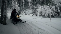 Snowmobiles travel on a winter forest road far from civilisation Stock Footage