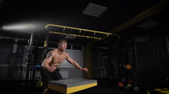Sportsman working out his body in box jumping Stock Footage