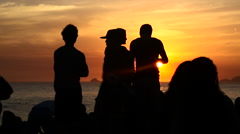 People watching sunset at Arpoador Rock on Ipanema Beach, Rio de Janeiro, Brazil Stock Footage