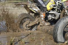 Enduro wheel in muddy track ,climb wood obstacle Stock Photos