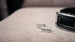Accessories groom lying on a chair, cuff links and belt - stock footage