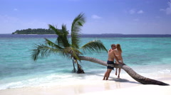 A couple in love kissing on a tropical beach. Maldives. Stock Footage