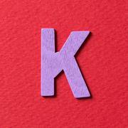 Wooden alphabet K in capital letter - stock photo