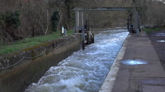 Flatford England river lock for historic mill 4K Stock Footage