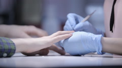 In the salon manicurist engaged with their work Stock Footage
