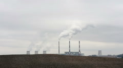 The steam, smoke comes out of factory chimneys Stock Footage