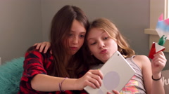 Preteen friends taking selfies with a tablet at home Stock Footage