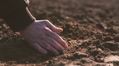 Farmer hands holding and pouring back organic soil. Soil, Agriculture, Sunlight. Stock Footage