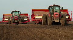 Potato tubers planting by using modern agricultural machinery - stock footage