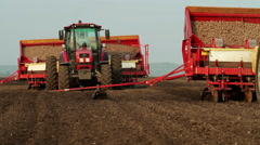 Potato tubers planting by using modern agricultural machinery Stock Footage
