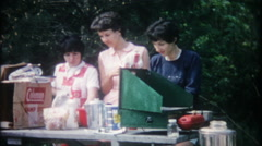 3 friends & family on weekend camping trip - vintage film home movie - stock footage