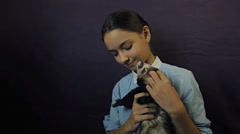 Ferret eats from the hand of the child Stock Footage