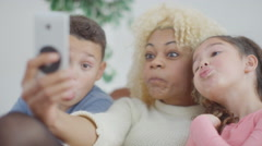 4K Happy mother & children at home pose for funny selfie with mobile phone Stock Footage