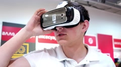 Sales Manager demonstrates the capabilities of the new device a virtual reali. Stock Footage
