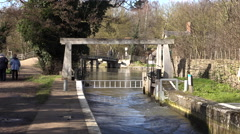Flatford England senior woman by historic river locks 4K Stock Footage