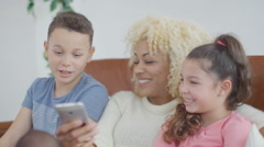4K Happy mother & children at home pose for funny selfie with mobile phone - stock footage