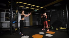 Crossfit ball fitness workout two woman Stock Footage