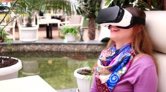 Girl hands catching virtual objects using Samsung Galaxy S7 Gear VR 2. Stock Footage