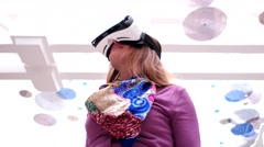 Girl is in the world of virtual reality with Oculus Samsung Gear VR 2 New Stock Footage