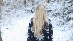 Woman walks in winter wood Stock Footage