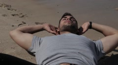 Athlete doing sit ups on the sand - stock footage
