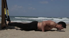 Push ups with fitness straps Stock Footage