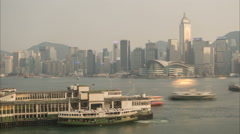 Time lapse of Star Ferry pier and Victoria Harbor in Hong Kong Stock Footage