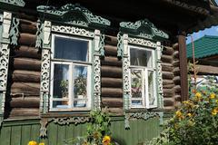 carvings window log farmhouse Russia - stock photo