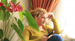 Woman on couch watching tv - stock footage