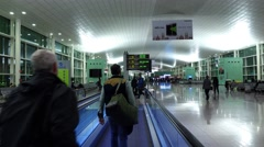 POV get off travolator, look to navigation board, Barcelona Airport at morning Stock Footage