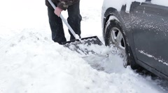 Man digs out his car from the snow. Stock Footage